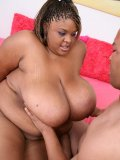 Big titted black whore licking her huge melons