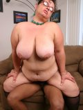 BBW seduces a black guy by unleashing her enormous set of fat knockers while sucking his cock